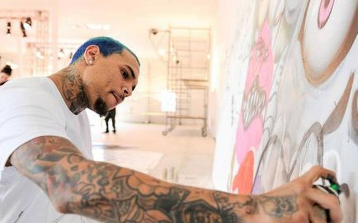 Chris Brown paints at SPACEBY3 SERGI - ALEXANDER GETTY IMAGES FOR FINE ART AUCTIONS MIAMI  Read more here: http://www.miamiherald.com/entertainment/celebrities/article10113035.html#storylink=cpy) 02/13/2015