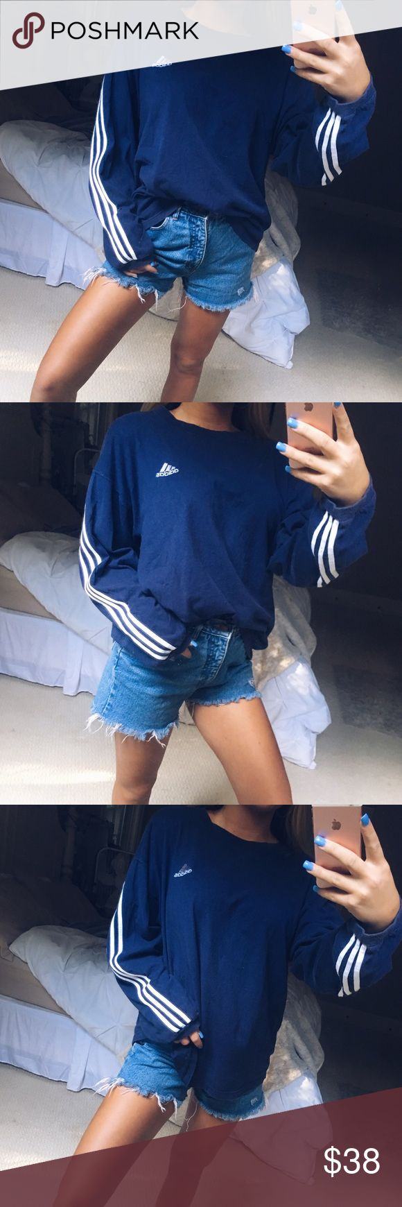 navy & white adidas tee super cute navy blue and white long sleeve oversized adidas tee. such a comfy and great for lounging in piece! has a bit of a retro look and vibe to it. looks so cute with some sweats or denim for a more day to day look! in excellent condition • size medium 🌿 adidas Tops Tees - Long Sleeve