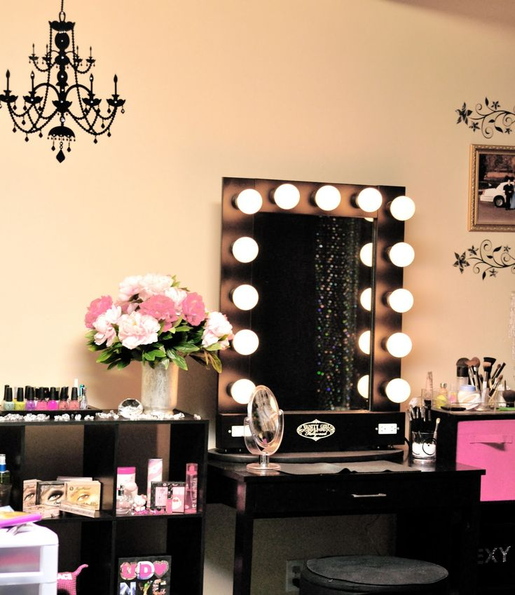 Exquisite antique chandelier over black makeup vanity with - Bedroom vanity mirror with lights ...
