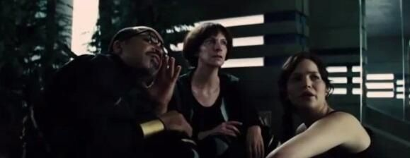 Katniss, Wiress and Beetee looking at the forcefield from the new clip!