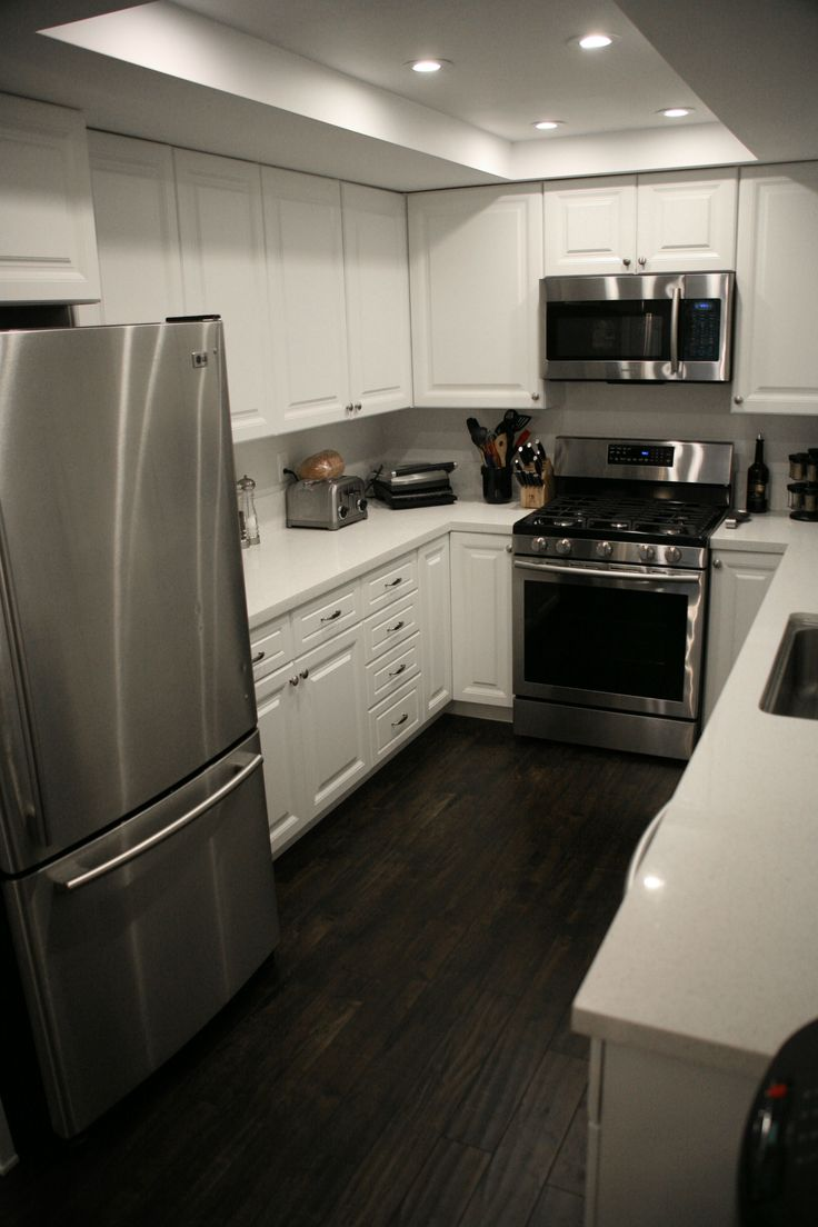 First home renovation white quartz countertops for Flooring or cabinets first