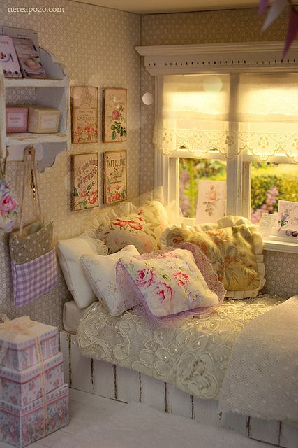 This bedroom could be within a cottage or a modern house - the devils in the detail - keeping to a pink, green and parchment colour palette, with patterns of the same size, charm and character is added without the room feeling cluttered due to a plethora of cute storage boxes keeping everything in its place.