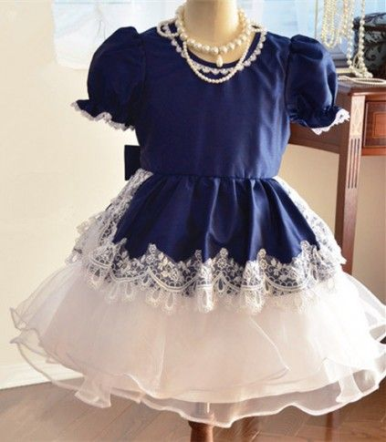 Let your infant spill Her Highness all over in this latest noble princess baby girl frocks in India. this wonderful combination made from smooth satin and chiffon is backed up by the delightful puffed half sleeves.