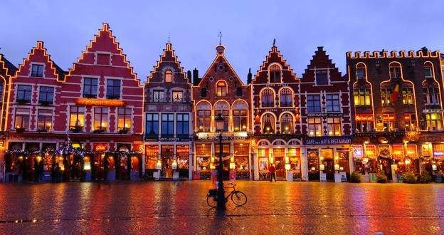 Medieval houses in Bruges' Market Square are illuminated over Christmas time. (Andrea Thompson Photography/Getty)