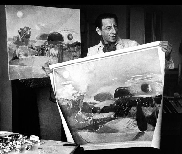 Paul Nash in his studio with two versions of 'Landscape of the Vernal Equinox', circa 1944