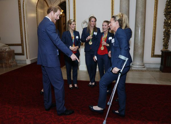 Prince Harry Photos Photos - Prince Harry meets the Ladies Hockey Team with Susannah Townsend on crutches at a reception for Team GB's 2016 Olympic and Paralympic teams hosted by Queen Elizabeth II at Buckingham Palace October 18, 2016 in London, England. - Olympics & Paralympics Team GB - Rio 2016 Victory Parade