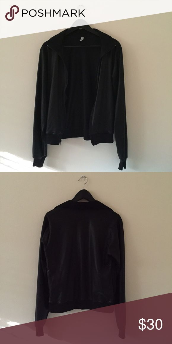 Discontinued American Apparel Black windbreaker American Apparel shiny windbreaker that is now discontinued. Size xx-small but I believe could also fit a x-small since it is a bit oversized. American Apparel Jackets & Coats
