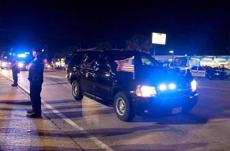 West Palm Beach Police stand along the sidewalk at President Donald Trump's motorcade travels to Mar-a-Lago Club in Palm Beach on Southern Boulevard in West Palm Beach February 2, 2018 in Palm Beach.  (Meghan McCarthy / The Palm Beach Post)