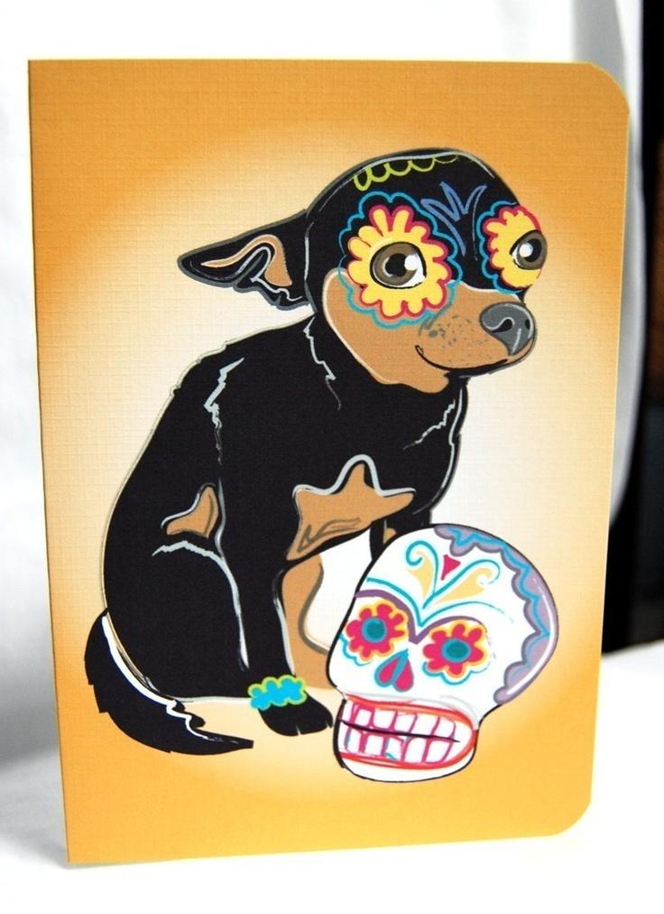 Muertos Chihuahua Greeting Card, framed on shelf.