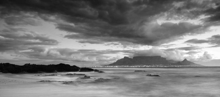 The iconic Table Mountain with Cape Town city lights below