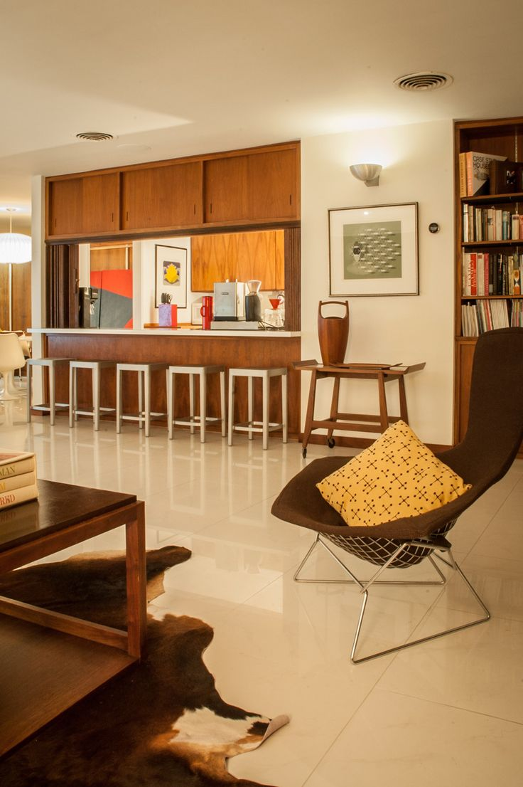 Very typical mid century kitchen config with beautiful accents of mustard  yellow.