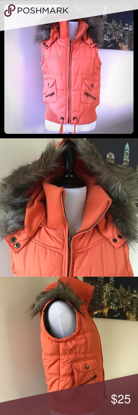 St. Bernard Orange Faux Fur Hooded Vest. St. Bernard Orange Faux Fur Hooded Vest. Purchased in Ireland. So soft and comfortable! US size 4 (see last picture of size chart)  In excellent condition- no holes, stains or damage noted.   FAST shipping! Same or next day shipping, always! Thanks for looking! St. Bernard Jackets & Coats Vests