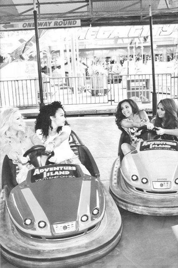 Models driving bumper cars at Adventure Island, Southend-on-Sea, Essex, England