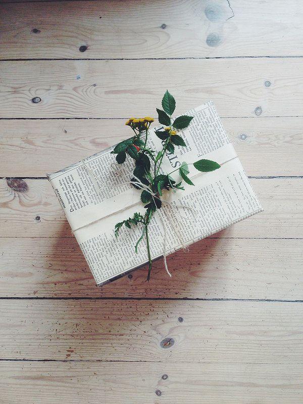 Newspaper + gift + flowers