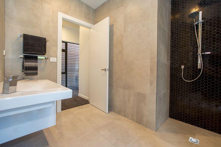Full height tiled bathroom including level entry walk in shower