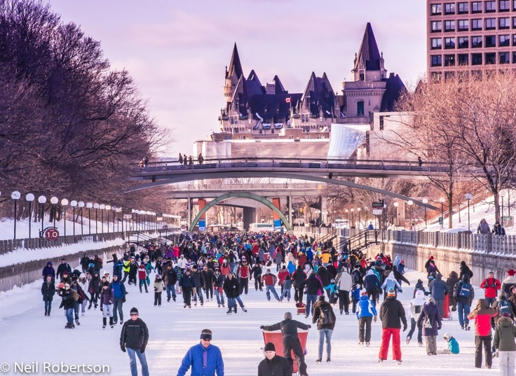 Ice skaters enjoying the Rideau Canal Skateway, the world's largest outdoor skating rink, in Ottawa, Canada. For more information on the Rideau Canal Skateway visit http://www.ottawatourism.ca/en/visitors/top-attractions/rideau-canal-skateway
