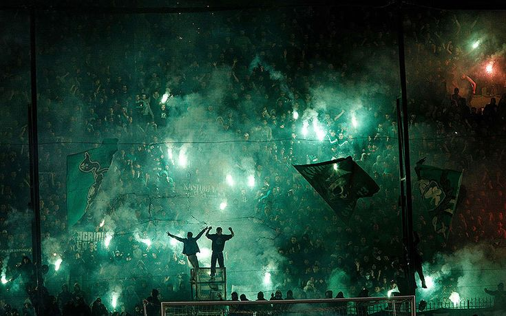 Panathinaikos' fans light flares after the cancellation of the Greek Super League match between Panathinaikos and Olympiakos at Apostolos Nikolaides stadium in Athens