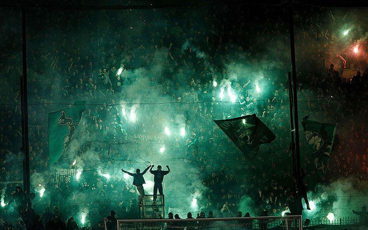 Panathinaikos' fans light flares after the cancellation of the Greek Super League match between Panathinaikos and Olympiakos at Apostolos Nikolaides stadium in Athens