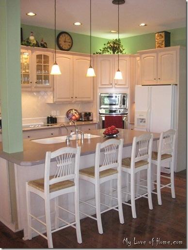 Bright cheerful kitchen dark wood floors light maple for Light green kitchen walls