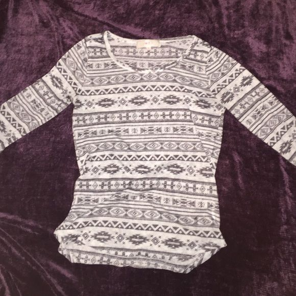 Black and white shirt Very nice black and white shirt with beautiful designs. The size says large but is a little smaller than that. Lightly worn. w.f. Tops Tees - Long Sleeve