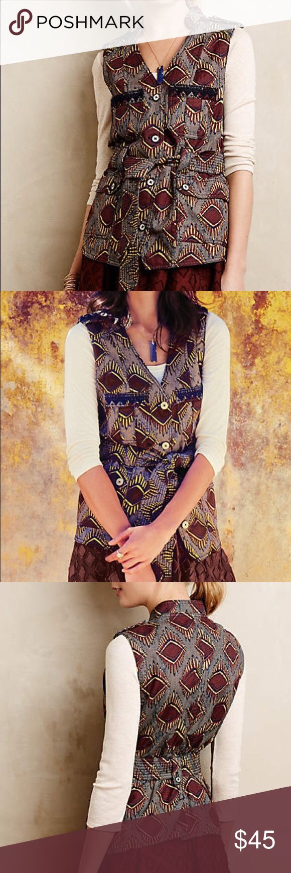 Anthropologie Elevenses safari vest Navy garnet and yellow tribal printed safari vest. Has a button detailing on the shoulder and buttons down the front. Has chest and front pockets. Has a belt. Mint condition. Size small by elevenses from Anthropologie. Retails $138. Anthropologie Jackets & Coats Vests