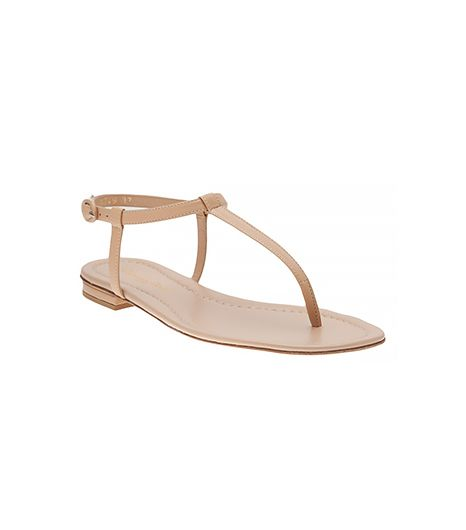 A nude sandal with minimal straps or buckles feels almost invisible, and hints that you are barefoot and fancy free. Opt for a t-strap style that is close to your skin tone.   Outdoor wedding shoe