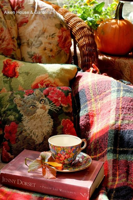 Autumn colours in the plaid blanket, floral chair cover and needlepoint cushion