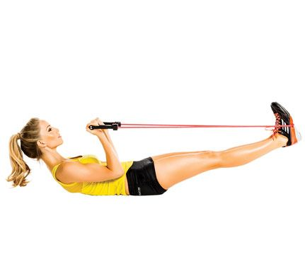 Tummy Toner  Lie faceup with center of band around feet, legs extended and hovering above floor, a handle in each hand, palms up, arms at sides to start. Curl hands toward chest with elbows at sides as you crunch up, raising legs a little higher (as shown). Lower to start; repeat. Do 20 reps.