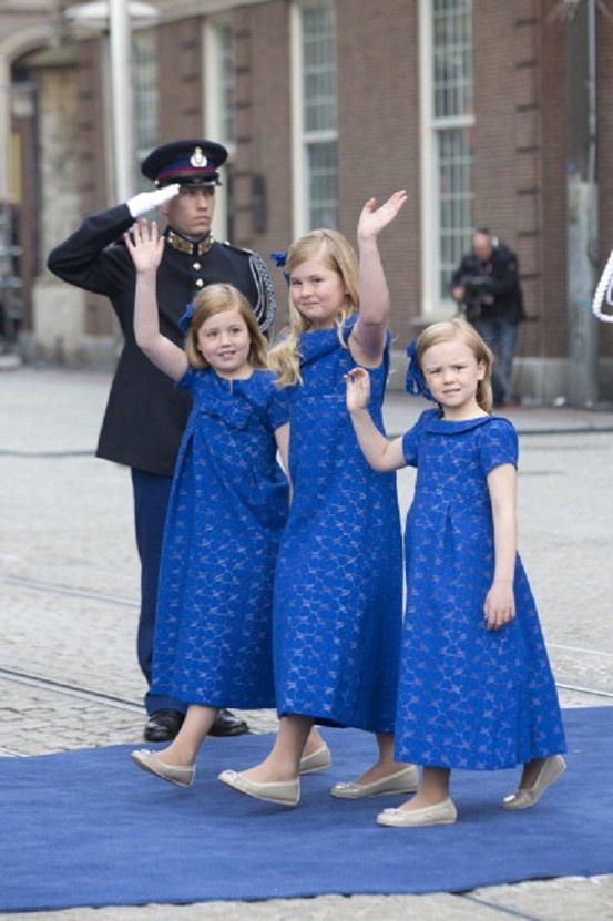 The Daughters of King Willem, and Queen Maxima of the Netherlands, (L-R) Princess Alexia, Princess Catharina Amalia, and Princess Ariane, waves to the crowd as they leave the Niuwe Kerk after the inauguration ceremony.