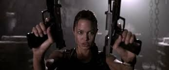 Heckler & Koch USP Match. The signature pistols of Lara Croft (Angelina Jolie) in the film are Heckler & Koch USP Match with stainless slides. The handguns are 9mm models, not .45 ACP as previously believed