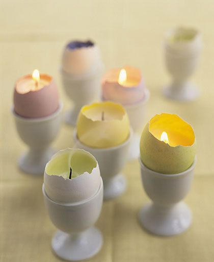 Easter: Make adorable candles from dyed eggshells in porcelain egg cups. A cluster of these makes a nice centerpiece. From Martha Stewart, of course.