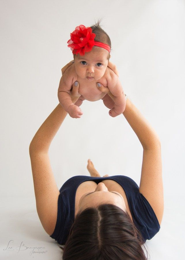 Chantel Reyneke and her little newborn in a above the head pose by Lee braganca photography