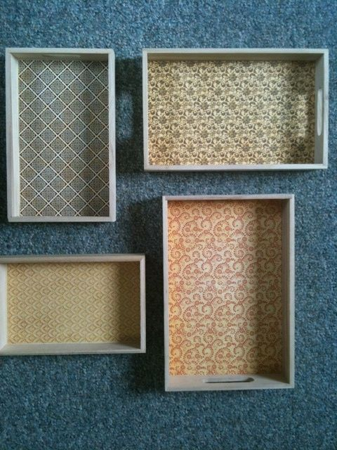 cheap trays + scrapbooking paper.  Maybe add some hooks for jewelry storage/display?