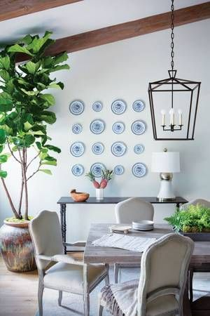 White And Blue Plate Collection In Dining Room