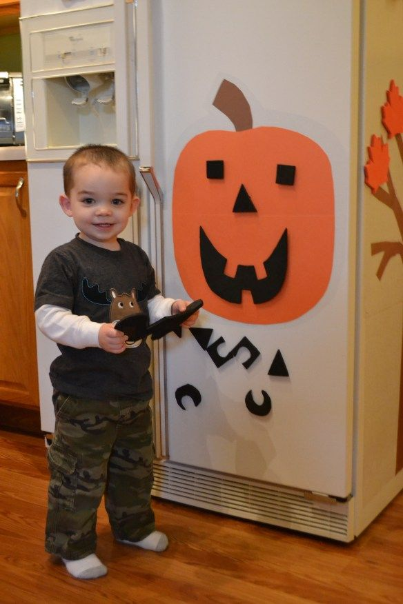 Use contact paper to stick the paper pumpkin to the fridge, and foam with magnets for the Jackolantern features. Love it!