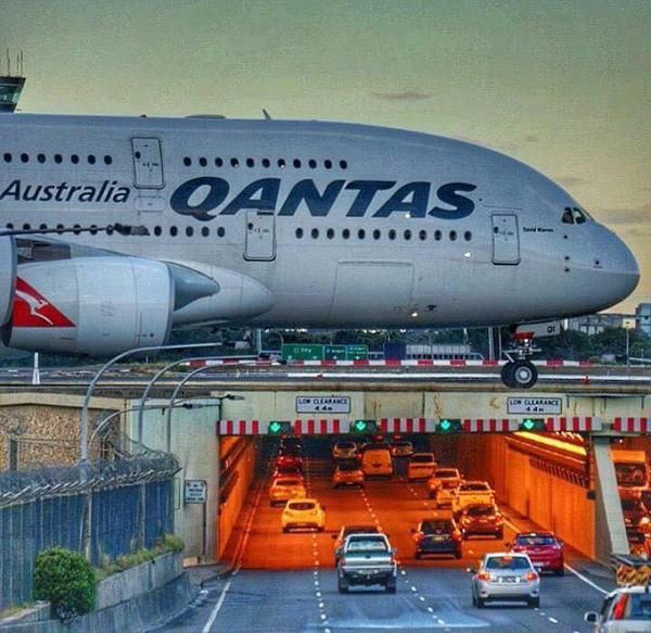 "Qantas Airbus A380-842 VH-OQI ""David Warren"" passes over General Holmes Drive towards the threshold of Runway 34L at Sydney's Kingsford Smith International, circa 2015."