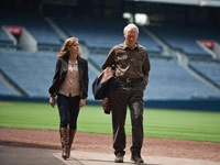 Like a big, looping knuckleball, Clint Eastwood's new movie Trouble With the Curve wanders amiably, threatens to go wild, but in the end settles smack in the middle of the plate.