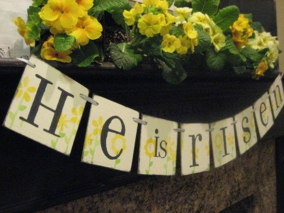 Easter Decoration HE is RISEN Banner. I like the yellow flowers on the mantel