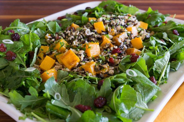 If you are looking for a hearty salad for your Thanksgiving dinner or holiday buffet, this recipe has it all. With wild rice and roasted butternut squash, it is substantial enough to serve as an entrée for your vegan and vegetarian guests. The salad greens are kale and arugula with assertive flavor and the sturdiness to hold up under the heft of the squash. Dried cranberries and chopped almonds lend the crunch and sweet and tangy balsamic vinaigrette dresses it all. This is one salad that…