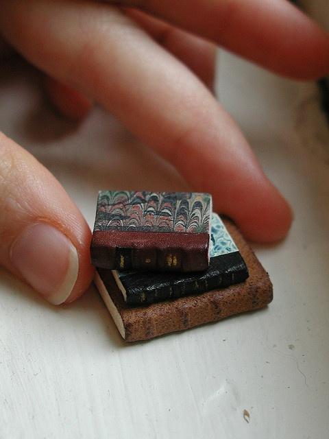 stack of miniature leather books - olaya