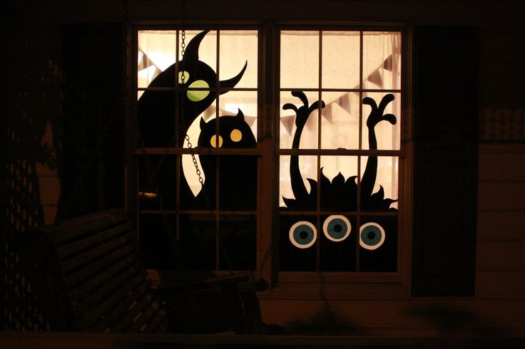 Four years ago I made monster silhouette Halloween decorations out of cardboard…