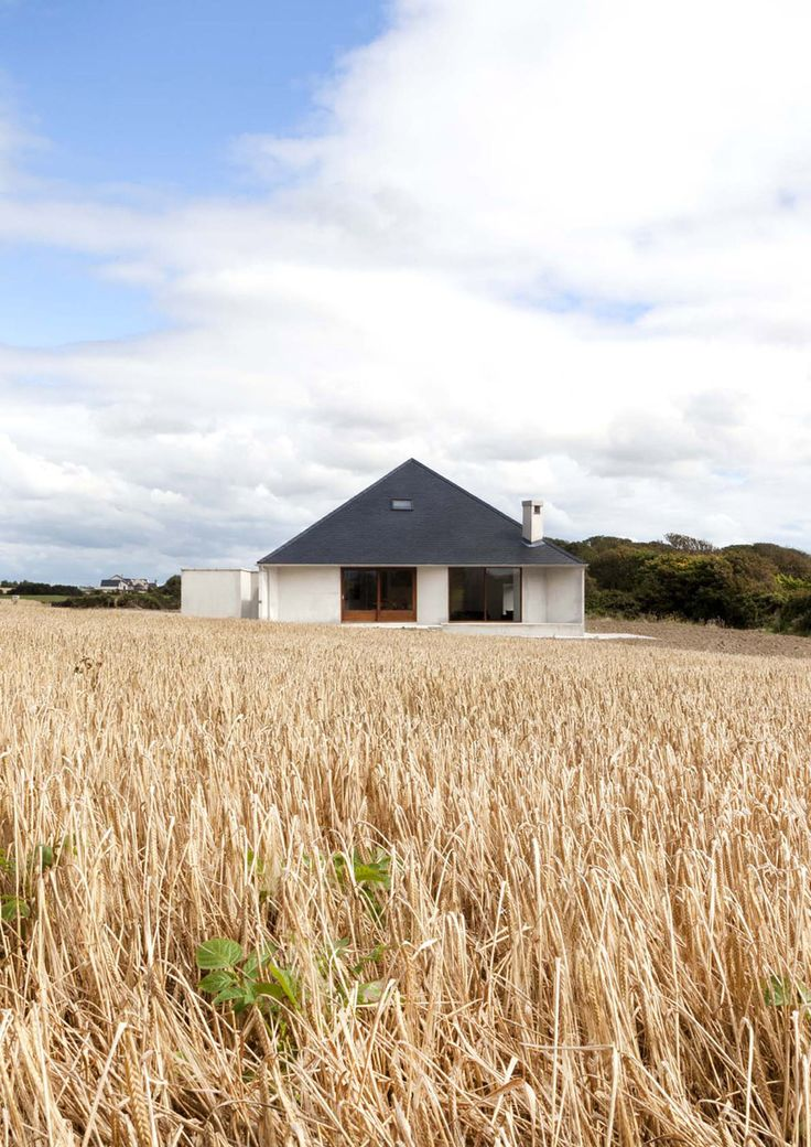 Dublin studio GKMP Architects added a pyramid-shaped roof to this compact house in rural Ireland.