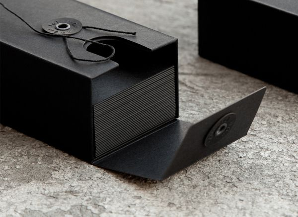 JOANNA: This can be seen as a form of envelope packaging which will hold the postcards inside. The black colour complements the paper colour of the cards inside. The type of closing the envelope has with the string are also an effective example of creative envelope design.