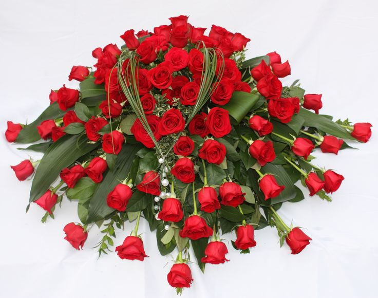 beautiful floral tribute of red roses for a loved one