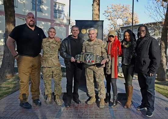 Gen John Campbell + sum of the WWE Wrestling team (The Big Show)  left