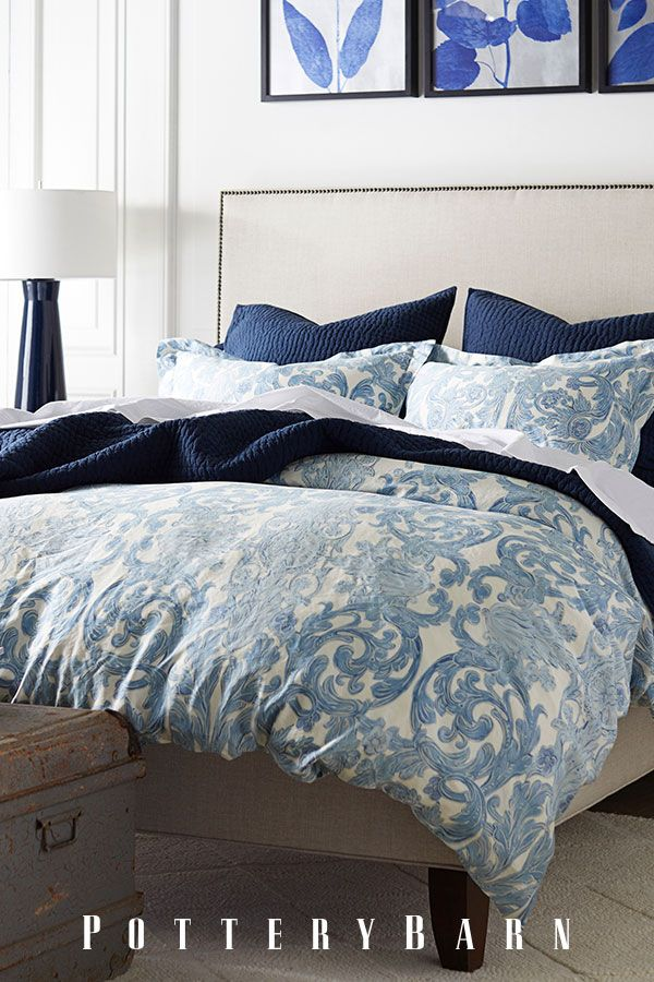 Blue and white bedding is a timeless look that can last thru any season. Top it off with oversized throw pillows and complimenting accents, like a navy blue bedside lamp.