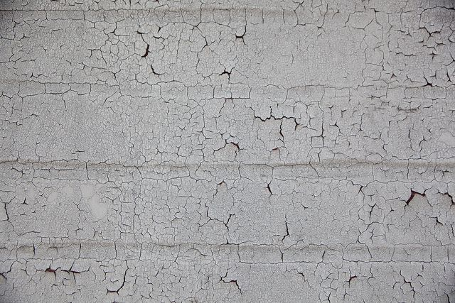 Cracked, crackle, distressed white paint on brick wall ...