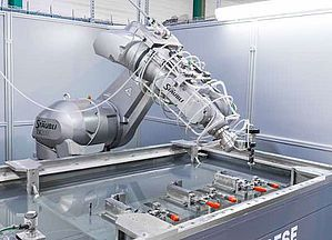 Robotic waterjet system produces a stream of water traveling at supersonic speed to cut a variety of materials, including superalloy components used in the aerospace industry. Courtesy: Shape Technologies Group/RIA