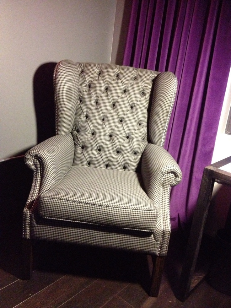 Black and white chequered wing chair made by Zinc Interiors