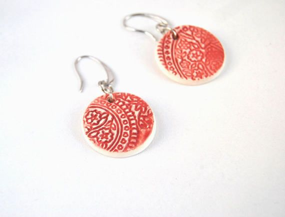 Handmade ceramic earrings made of white clay and decorated with a beautiful ancient doily texture. The pieces has been fired twice to make it more resistant and the back of it has been left underglazed to avoid any skin irritation. Nickel free, lead free and hypoallergenic hook. Fired twice to make it more resistant; the back of the jewel has been left underglazed to avoid any skin irritation. Due to its handmade nature the necklace is a unique piece, really lightweight and a perfect gift…